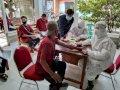 Gunakan Protokol Kesehatan, Pemkab Gowa Jemput 14 TKI dari Malaysia di Bandara Sulhas